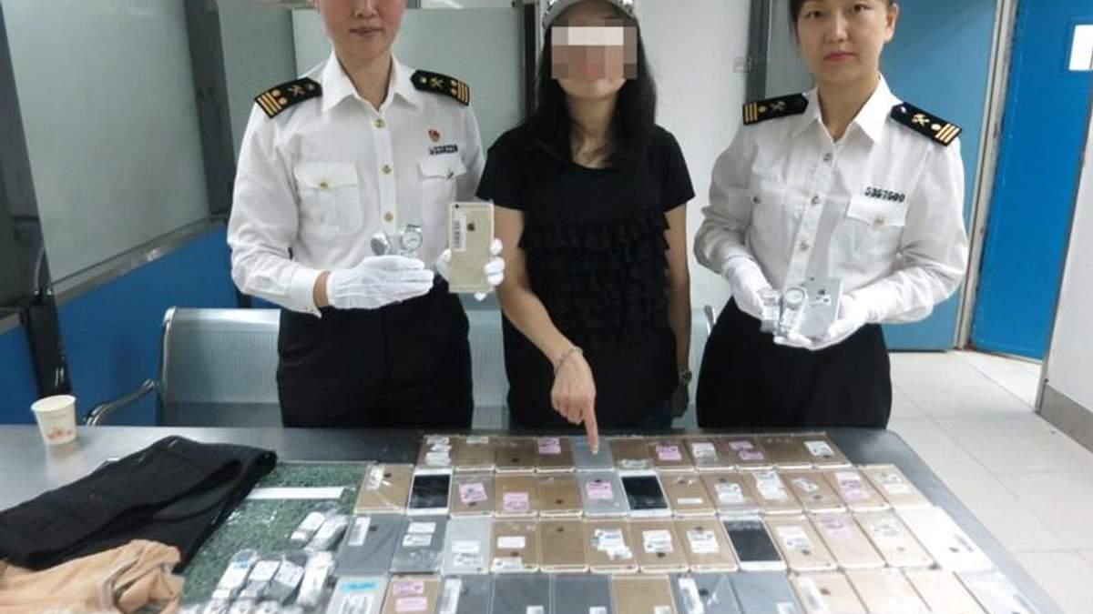 Китаянка пыталась провести на себе 102 iPhone