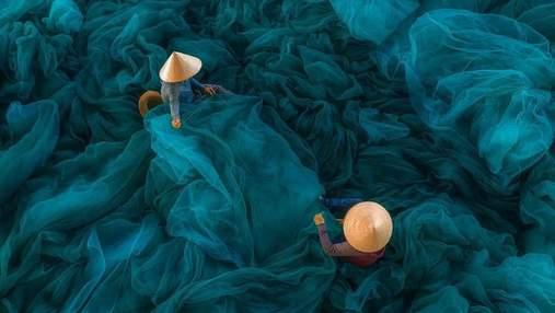Повседневность как произведение искусства: фотограф из Вьетнама показала невероятные фото страны
